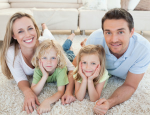bigstock-Family-lying-on-the-carpet-tog-28418636